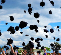 graduates throwing cap on the air