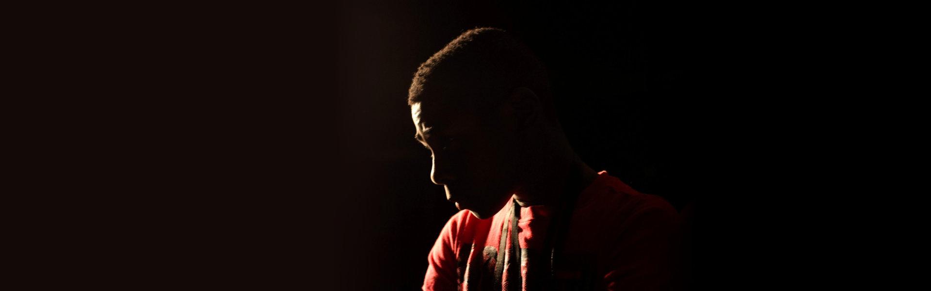 guy in a dark room
