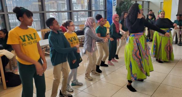 zumba instructor teaching kids to dance