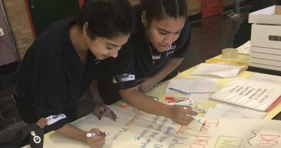 Two ladies writing