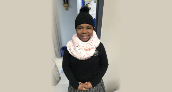 Ashlie models the new scarf she made in Crochet Club