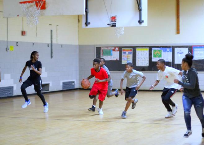 group of people playing bastketball