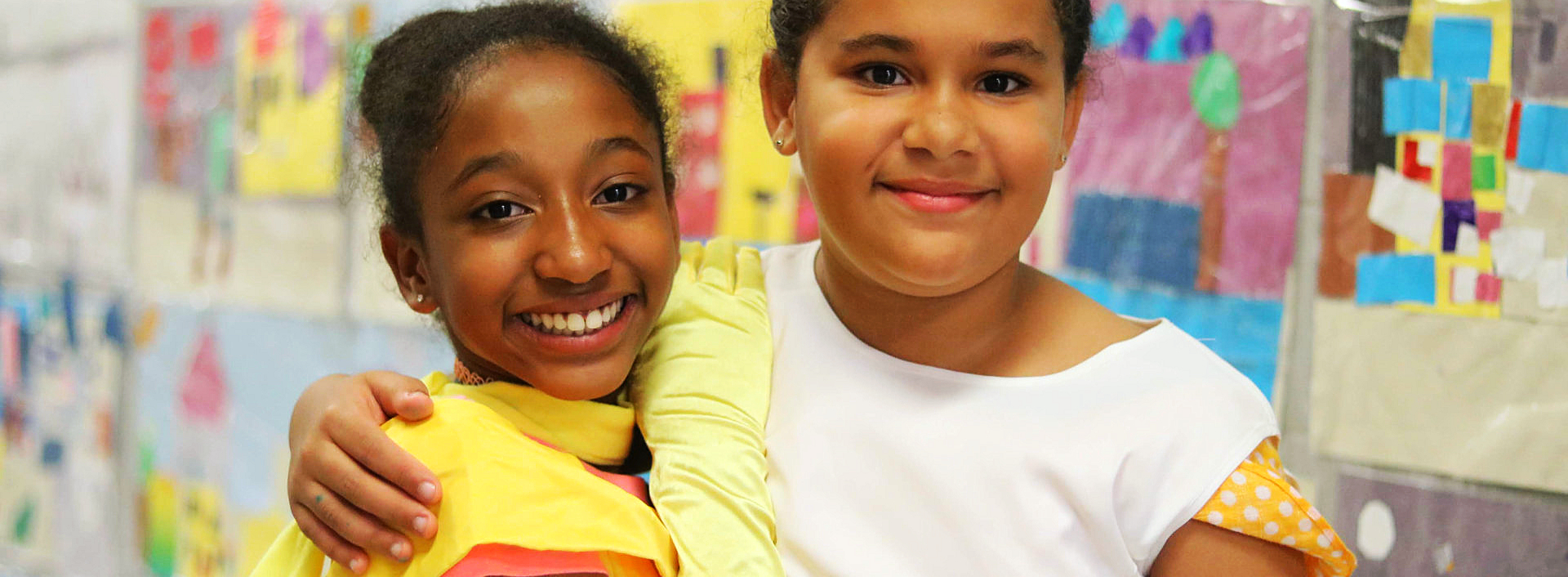 Two young girl smiling