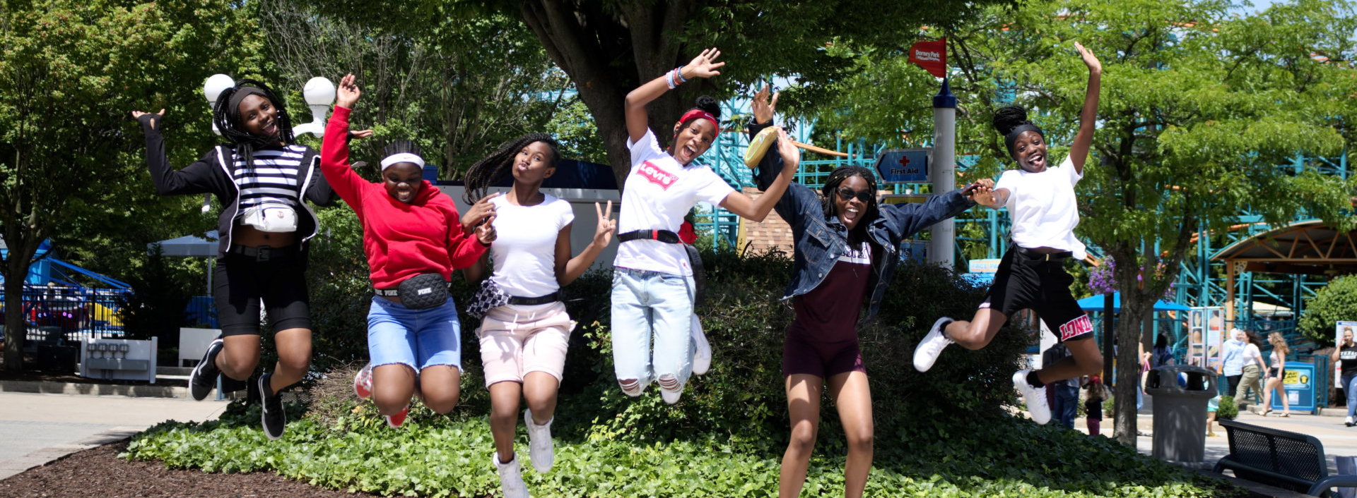 teens jump and smiling