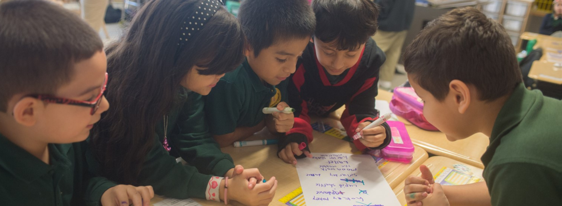 Group of students writing